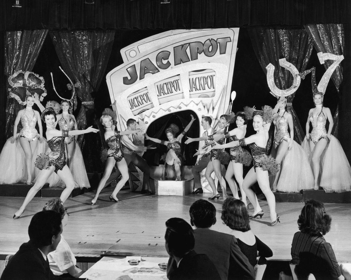 Slide 10 of 50: Showgirls perform Jackpot at a casino in 1955. The showgirls worked constantly, sometimes even up to three appearances in a day.