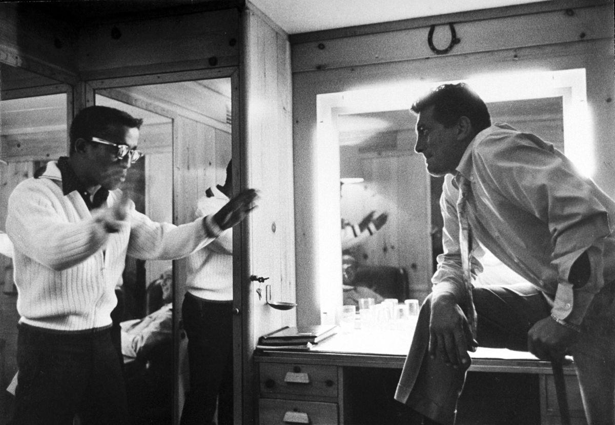 "Slide 22 of 50: Dean Martin and Sammy Davis Jr. goof around in a dressing room in 1958. Martin's nickname was ""The King of Cool."""