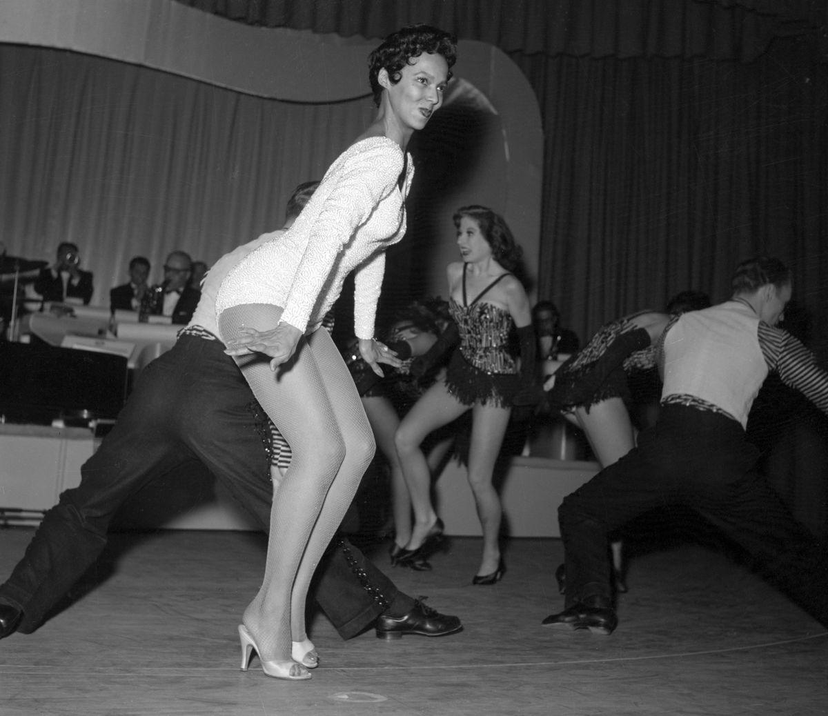 Slide 42 of 50: Dorothy Dandridge dances in a sequin leotard during her Las Vegas nightclub debut performance at the Riviera Hotel.