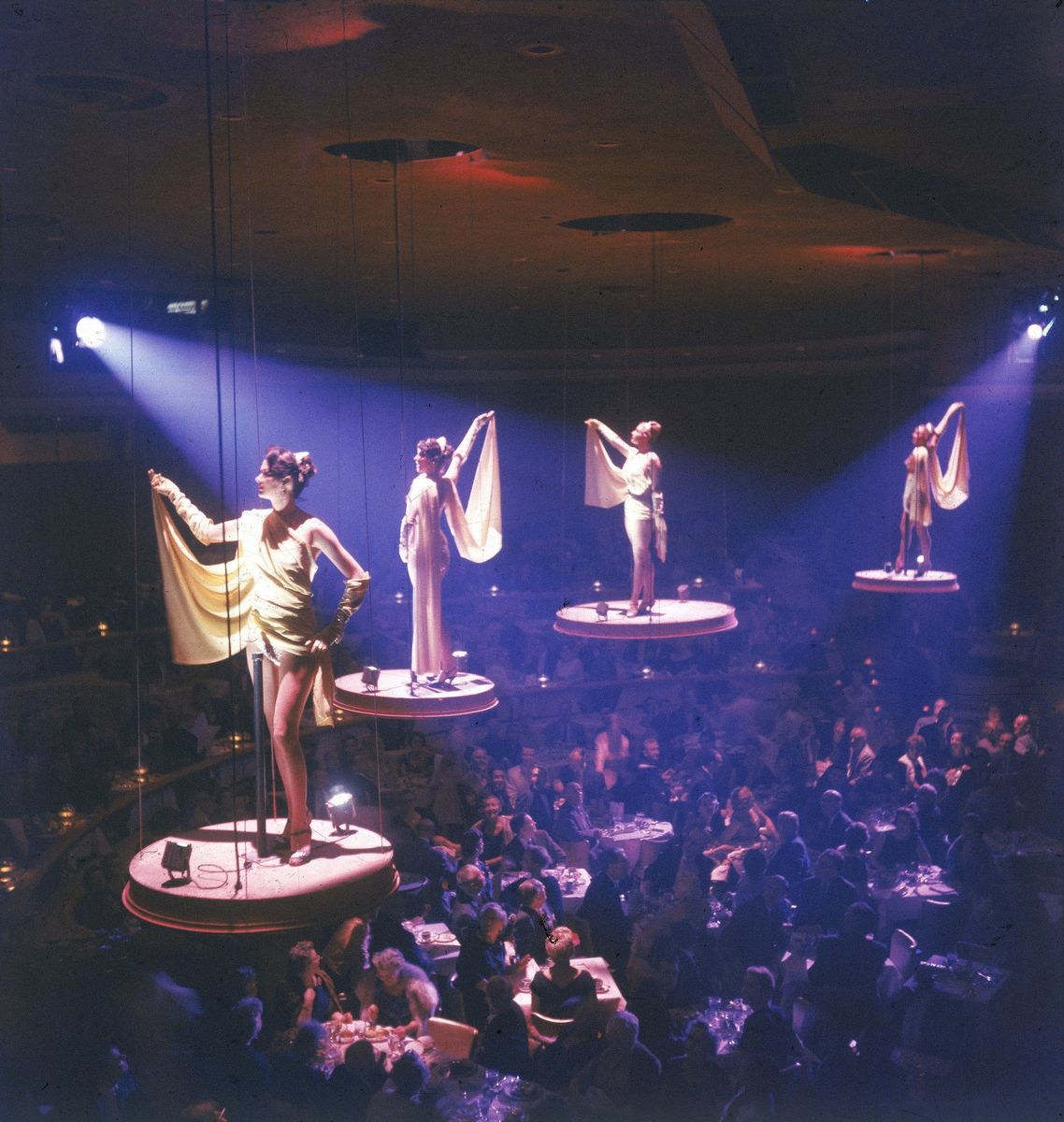 Slide 46 of 50: The Bluebell Girls pose on aerial platforms at the Stardust Hotel. This well-known group typically performed at the Lido Nightclub in Paris, France, but journeyed to Las Vegas in 1958.