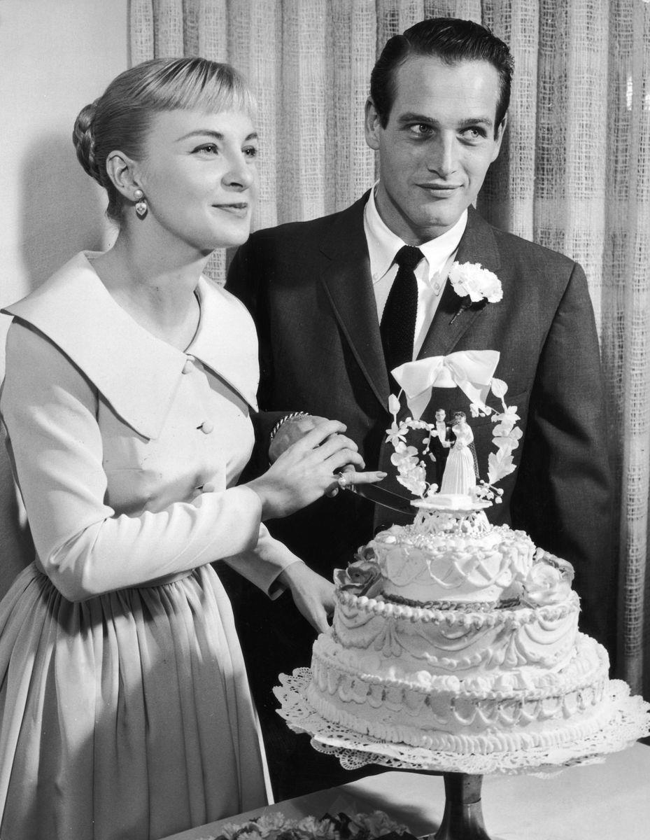 Slide 50 of 50: Hollywood heavy hitters, Joanne Woodward and Paul Newman, pose with their wedding cake following a Las Vegas ceremony in 1958. The couple was married for 50 years.