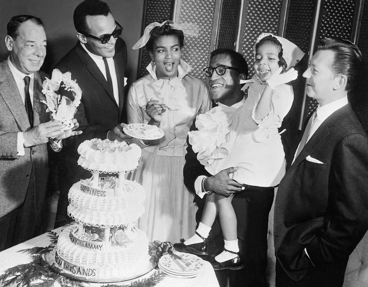 Slide 14 of 50: Sammy Davis Jr. during his wedding to Lory White at the Sands Hotel in 1958. They would divorce two years later.