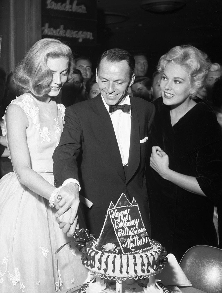 Slide 20 of 50: Lauren Bacall, Frank Sinatra, and Kim Novak at the Sands hotel on September 14, 1956. During its heyday, the Sands was the center of entertainment and activity on the Strip.