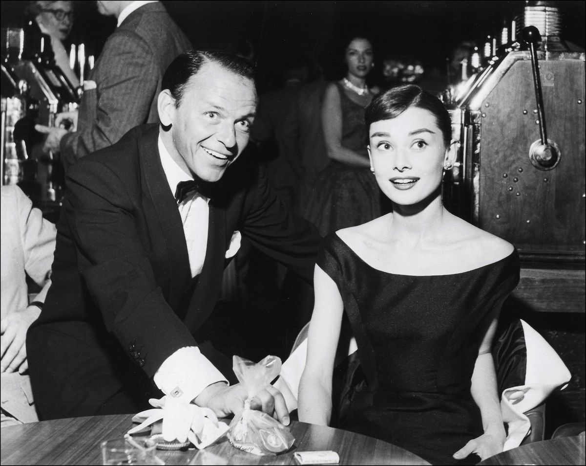 Slide 11 of 50: Frank Sinatra and Audrey Hepburn at the Sands in 1956. The two actors were both Oscar winners the same year (1954), yet never appeared in a film together.