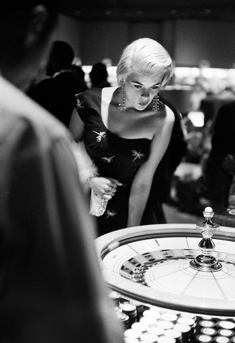 Slide 23 of 50: Jayne Mansfield at the roulette table in 1958. The nightclub entertainer and singer was one of the early Playboy Playmates.