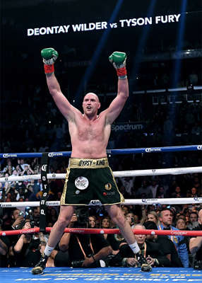 a man jumping in the air: Tyson Fury credits Daniel Kinahan for getting the deal to fight Anthony Joshua over the line. Pic: Harry How/Getty Images