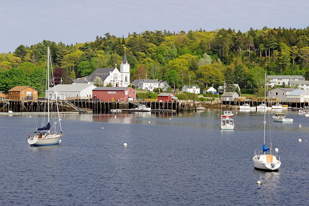 Slide 2 of 21: Located on the coast of the North Atlantic, Boothbay Harbor is a small harbor town that probably features more boats than cars. With a population of about 3,130, this is seriously tiny, but in the best way. The very walkable village is packed with restaurants that serve the most incredible seafood, and there are hiking trails near by. Don't miss an authentic New England clambake that takes place a ferry ride away on Cabbage Island.