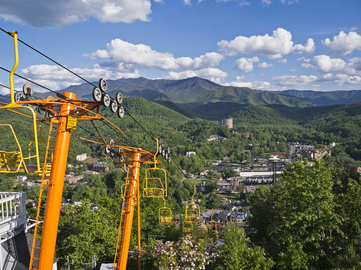 Slide 11 of 21: A small mountain town in eastern Tennessee, Gatlinburg is super scenic and perfect for nature-lovers. It's located right alongside the Great Smoky Mountains National Park, making it the perfect stop before or after some hiking. Be sure to check out the Space Needle observation tower and the Sky Lift, an aerial cable car, for some gorgeous views.