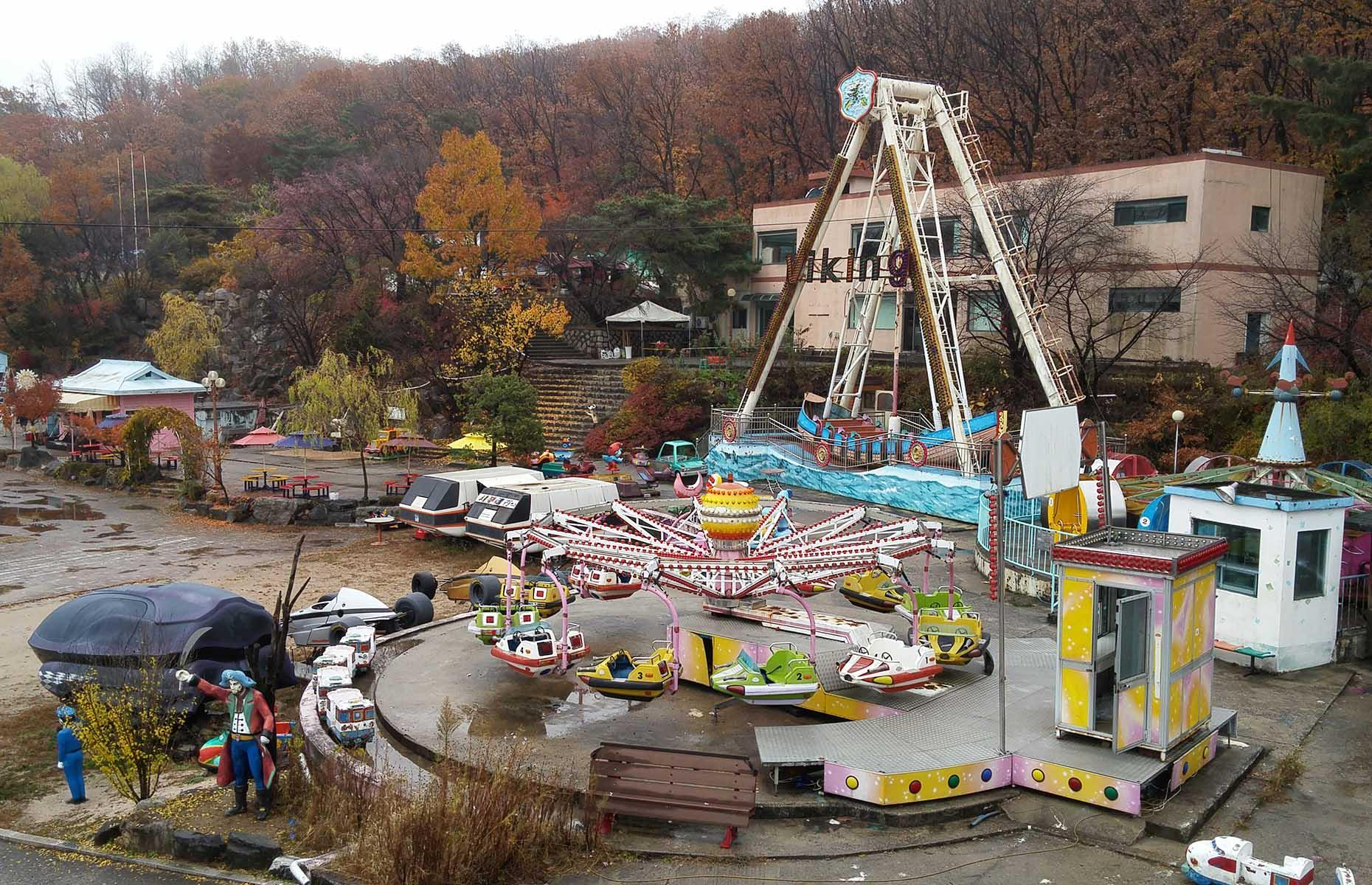 Slide 23 of 40: This tiny abandoned theme park has now become an attraction in itself. While you can't ride the merry go rounds or dodgems at Yongma Land, pay a small fee to enter and you can wander among the derelict grounds as you wish.