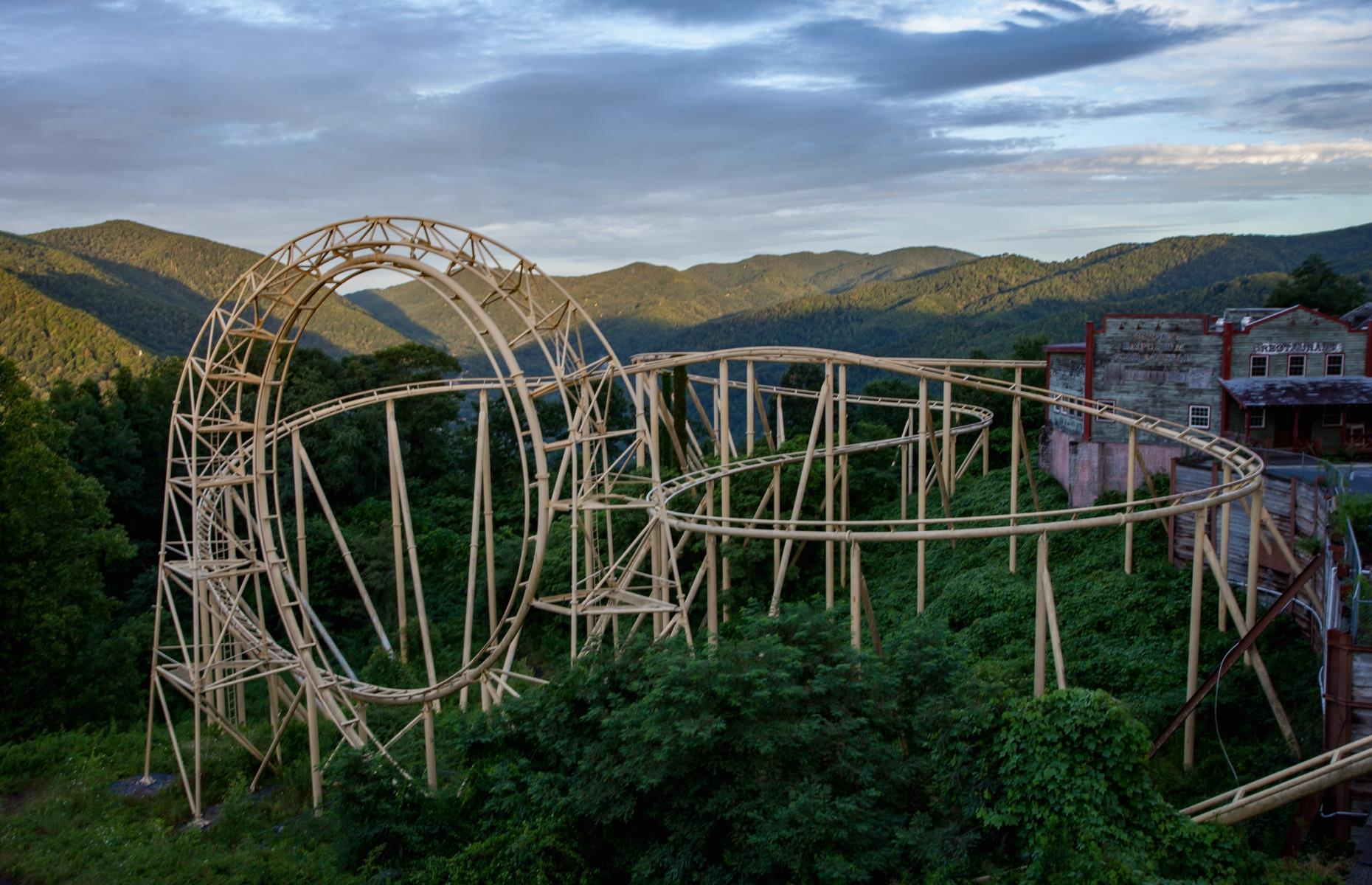 Slide 33 of 40: Known as Ghost Town in the Sky, this abandoned Wild West-themed amusement park has seen as many ups and downs as its Red Devil roller coaster pictured here. Located on Buck Mountain, a mountaintop site towards the bottom of the Great Smoky Mountains, the park opened in 1961 and closed for good in 2016. Today it lies in ruins. It's featured here courtesy of Abandoned Southeast, in images taken by photographer Leland Kent.