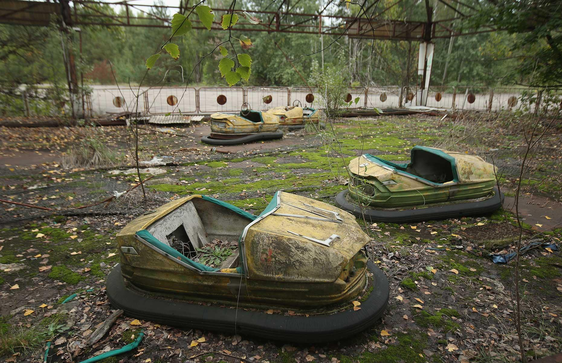 Slide 38 of 40: This now derelict amusement part tells a wider, more tragic story than just a few abandoned Ferris wheels. Located in Pripyat, Ukraine, the park was one of the many areas of the city to be left behind by residents after the devastating Chernobyl disaster of 1986.