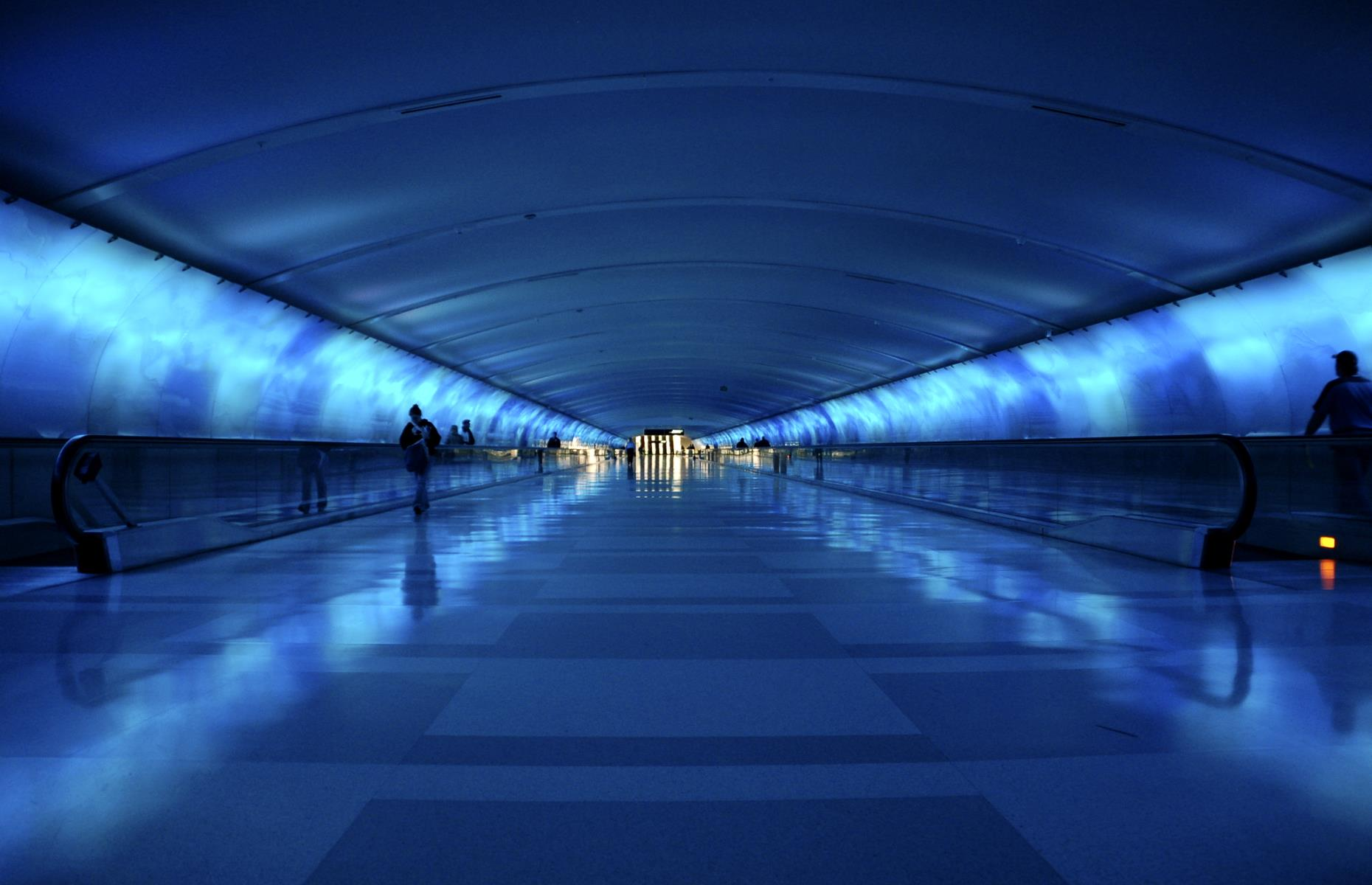 Slide 23 of 31: Who says airport infrastructure needs to be boring? Detroit Metropolitan Airport's underground Light Tunnel goes to show that it can be both aesthetically pleasing and functional. The 700-foot-long (213m) tunnel which connects two concourses features nearly 9,000 feet (2,743m) of glass panels and is illuminated by LED lighting. An original musical score also entertains passengers as they travel along the moving walkways.