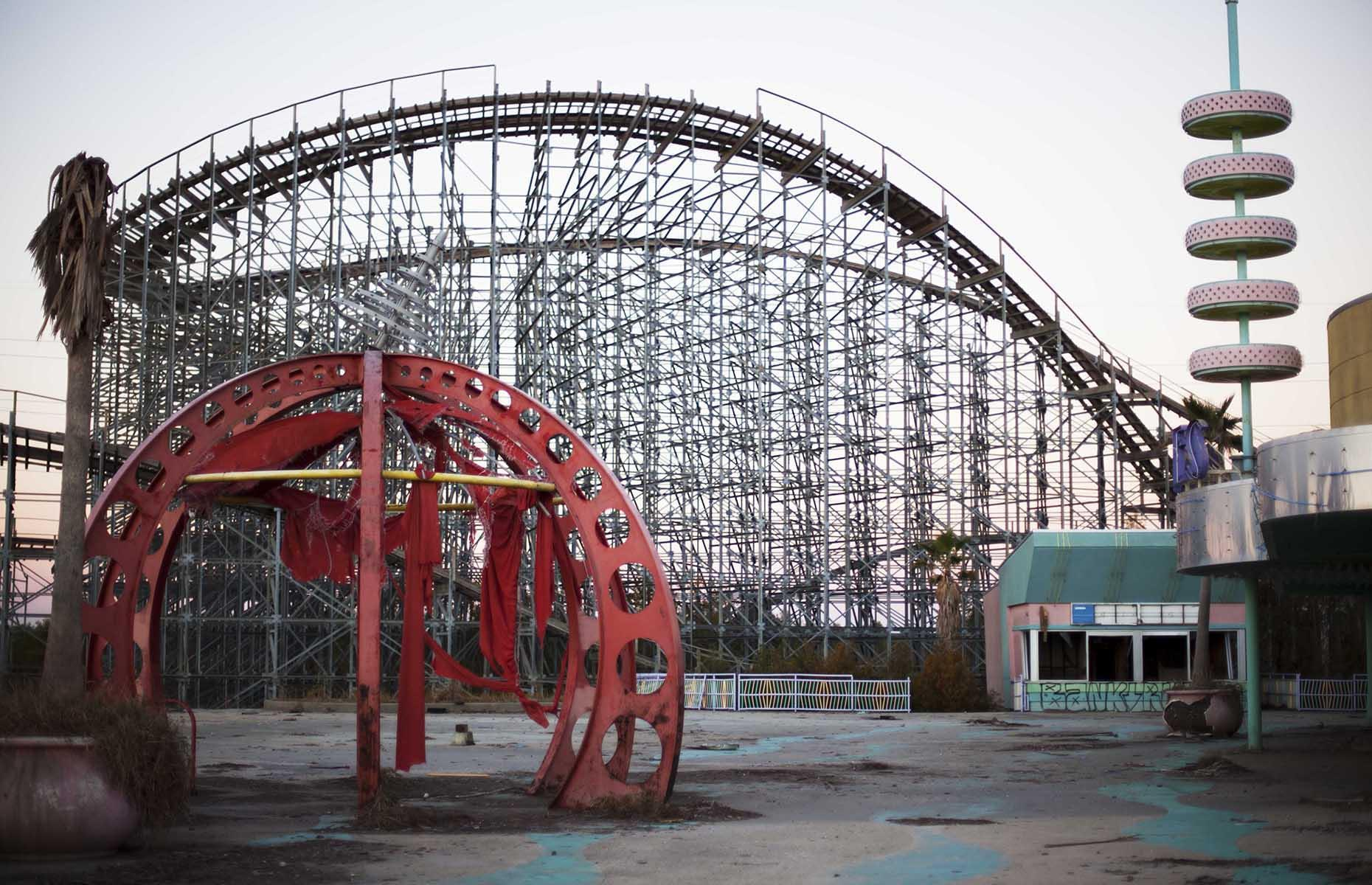 Slide 15 of 40: Instead of the screams of joy and laughter once heard in the park, it's now silent, with graffiti gracing almost every surface, and disused roller coasters, dodgems and Ferris wheels rusting away, never to be used again.