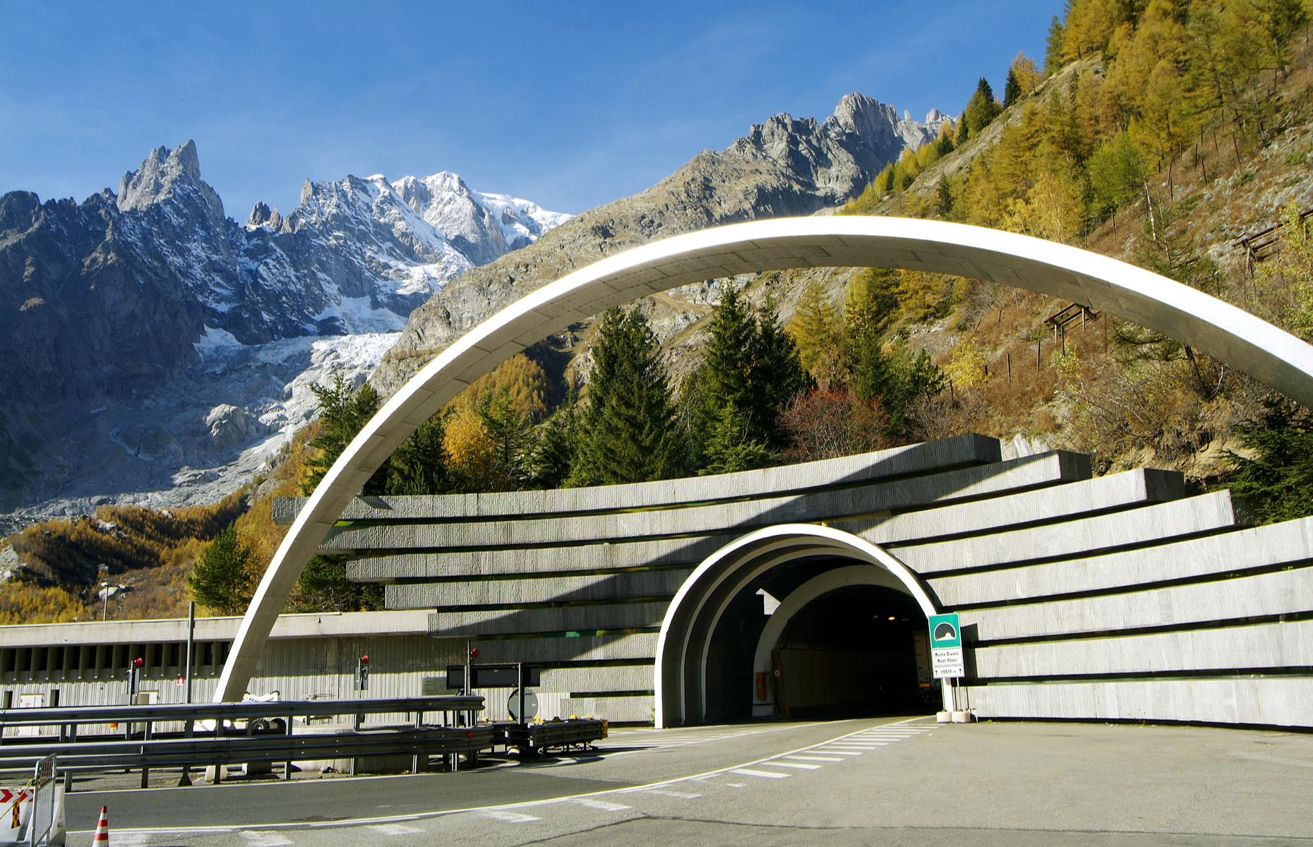 Slide 10 of 31: Another feat of modern engineering when it opened in 1965, the Mont Blanc Tunnel was the world's longest road tunnel at 7.2 miles (11.6km). Today it remains a vital link for truck drivers and skiers, among others, linking Chamonix in France with Courmayeur in Italy's Aosta Valley as it takes them under the Europe's tallest mountain, Mont Blanc. The tunnel passes almost exactly under the summit, where it's more than 8,000 feet (2,500m) beneath the surface.