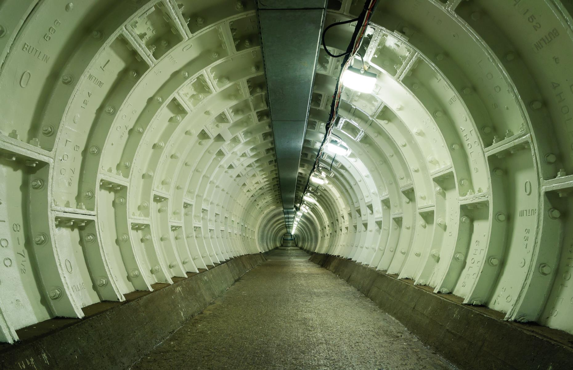 Slide 25 of 31: Built in 1902 to allow south London's dockworkers easier access to the docks, the cast iron Greenwich Foot Tunnel runs under the Thames from Cutty Sark in Greenwich to the Isle of Dogs on the north side. It's 1,214feet (370m) in length and around 50 feet (15m) deep with a spiral staircase at either end. Elevators were later added in 1904. Entrance is through two grand large glazed domes at either end, which along with the tunnel are listed structures. Along with the Woolwich Foot Tunnel, which opened in 1912, the passages were restored recently and are now used by 1.5 million people a year.