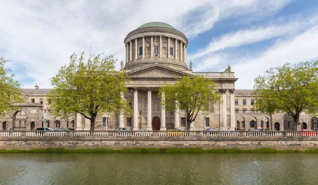 a castle with water in front of a building: In the High Court, Joanne Hayes is still seeking declarations that the investigation, as well as her questioning, arrest, charge and prosecution on dates between April and October 1984, were unfounded and in breach of her constitutional rights. Pic: Shutterstock