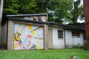 a building with graffiti on the side of a house: A mural decorates a building on College St, near the Stax Museum of American Soul, Thursday, Sept. 24, 2020, in Memphis, TN.