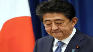 Shinzo Abe wearing a suit and tie