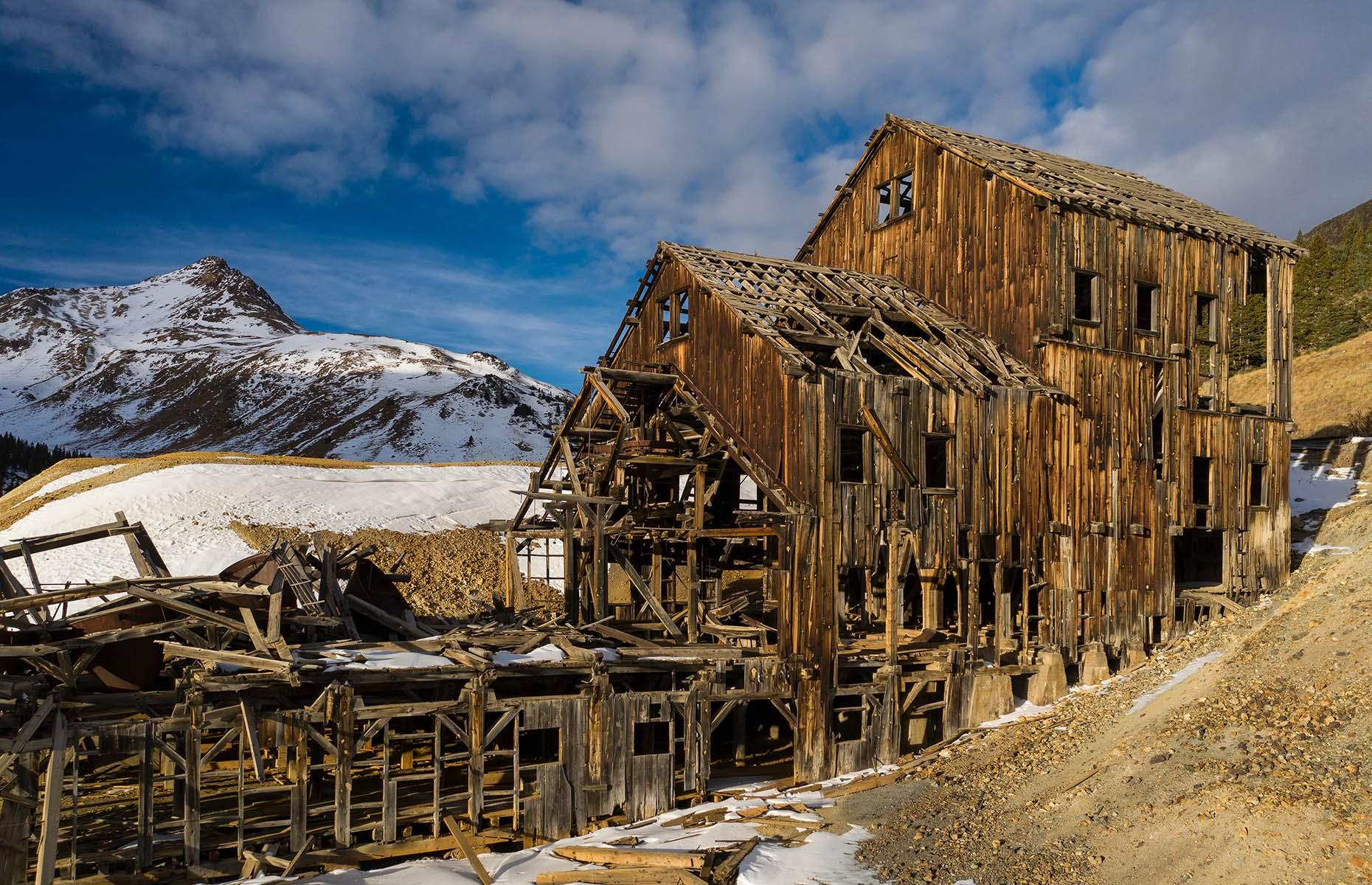 Slide 12 of 46: With no more gold left to prospect in the mountains, dealing with Colorado mountain winters suddenly became extremely unappealing and the town was swiftly abandoned. Today, visitors can explore the deserted village, including the gold processing plant, all of which is frozen in time.