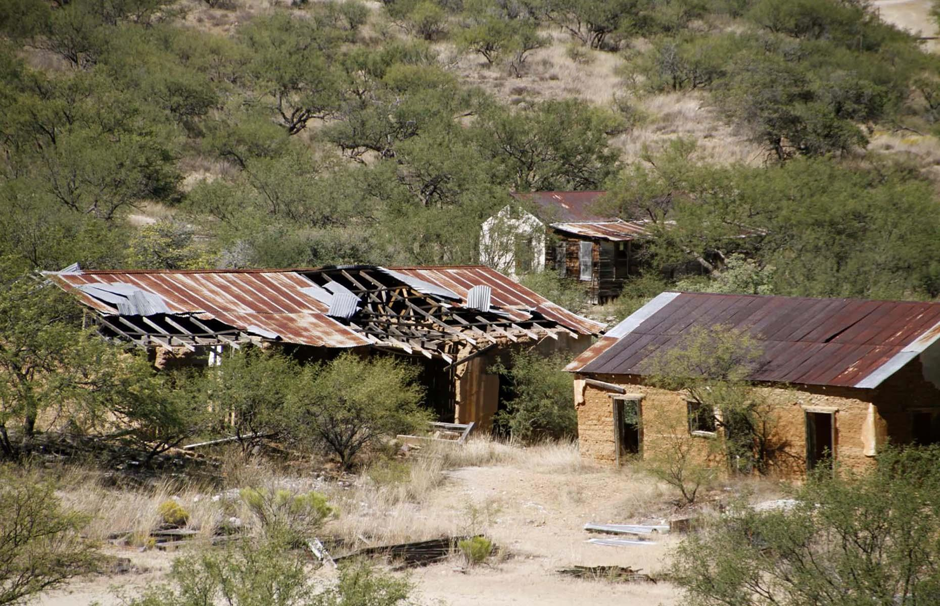 Slide 35 of 46: Four miles (6.5km) north of the Mexican border deep in the south of Arizona lies Ruby, surrounded by the Coronado National Forest in an area of rugged mountains, semi-arid deserts and abundant wildlife. Once the largest mining camp in the region, now wild vegetation has invaded most of the buildings, making for an eerie site.