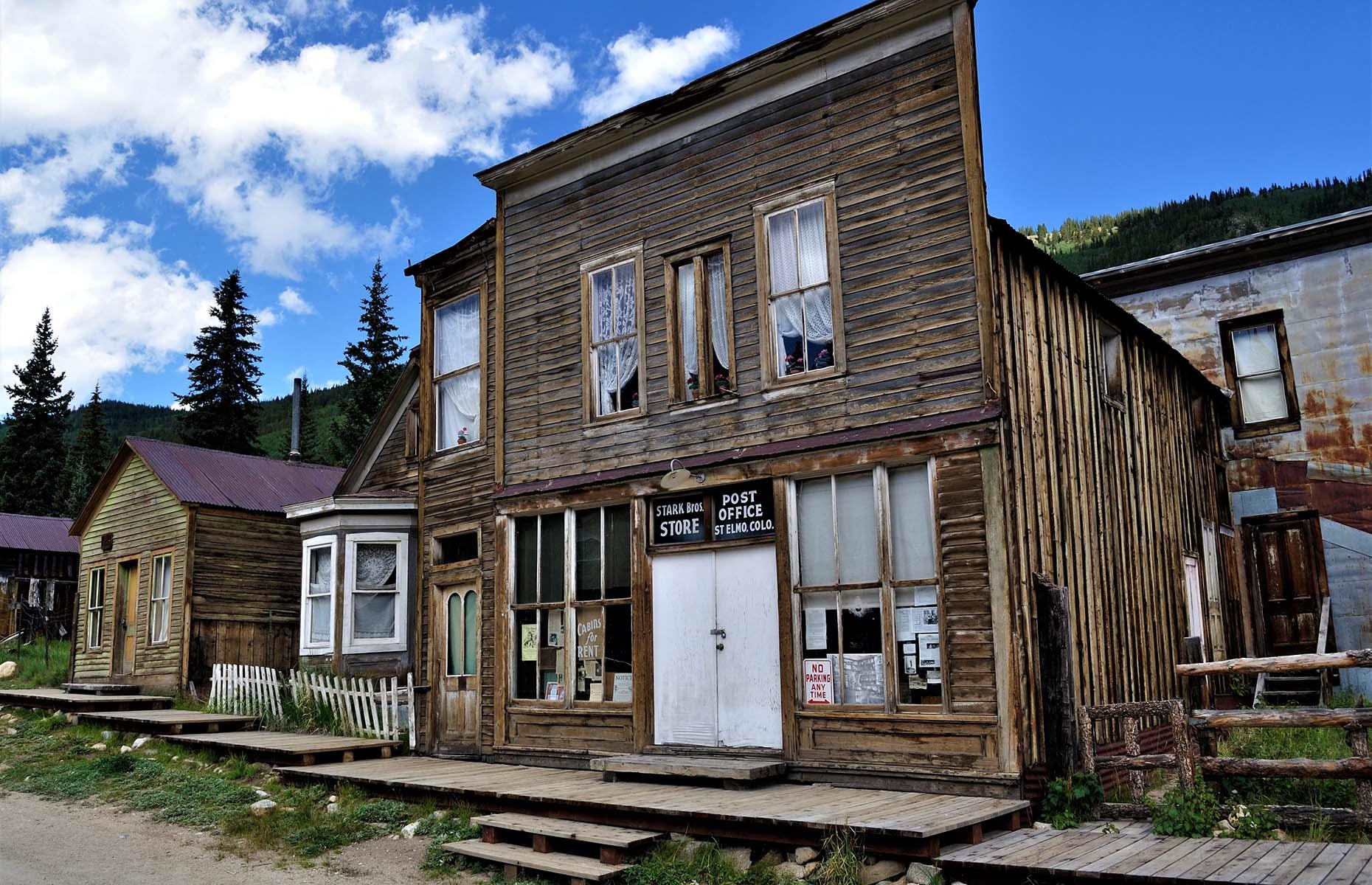 Slide 15 of 46: Though it is considered a ghost town, a handful of residents still live among the old buildings and while it's not easy − there hasn't been a post office since the St Elmo postmaster passed away in 1952 – the town still survives on travelers passing through or coming to explore the fascinating stories of the Gold Rush-era.