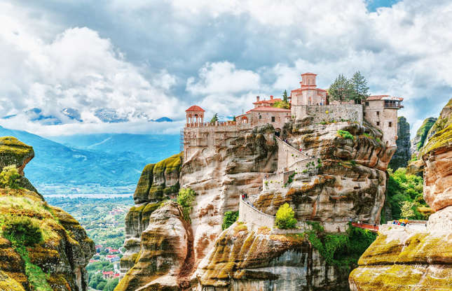 Slide 7 of 31: As clifftop monuments go, the Meteora Monasteries in Greece's Thessaly region are about as famous as they get. And it's not hard to see why. Perched upon 60 million-year old sandstone megaliths which rise an average of 1,000 feet (305m) into the air, these Byzantine monasteries are the rocks' crowning glory. Built between the 14th and 17th centuries, today the area is one of the most visited in Greece, although visitors must climb 200 dizzying steps to reach Roussanou, the most famous of the monasteries. Planning a trip to Greece? Here are 6 things to consider when planning a Greek holiday in 2020.