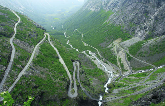 Slide 12 of 31: Trollstigen is a scenic road in northwest Norway which snakes its way up the steep mountainside to Stigrøra, some 2,800 feet (858m) above sea level, encompassing 11 hairpin bends along the way. Not one for the faint hearted, visitors who make it to the top typically go to the Trollstigen platform, which offers panoramic views of the Stigfossen waterfall and steep-sided valley below. Here are the world's most amazing roads as you've never seen them before.