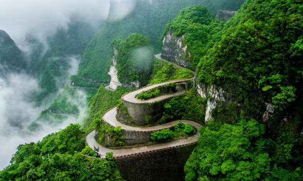 Slide 2 of 31: Snaking around the Tianmen Mountain in the Hunan Province of central China, this deadly-looking road is also known as the 99-Bend Road, for the fact it contains a whopping 99 twists and turns spread across seven miles (11.3km). For visitors wishing to keep their breakfast down, a cable car typically operates between City Garden downtown and the mountain's summit.