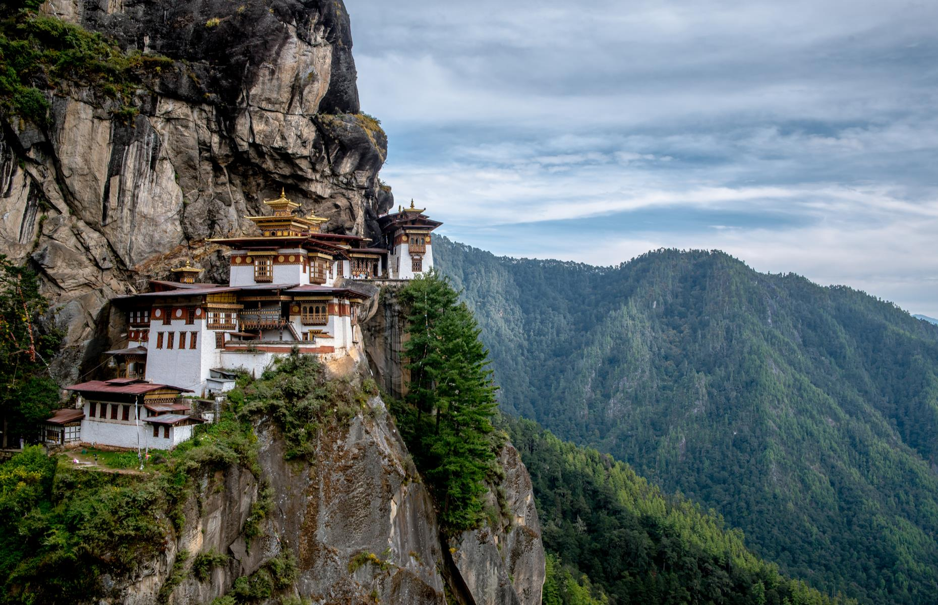 Slide 6 of 31: Clinging to the edge of a cliff with panoramic views over the Paro valley in Bhutan, the Buddhist monastery of Paro Taktsang – also known as Tiger's Nest Temple – is a sight to behold. Built in the 17th century, the sky-high temple rises a perilous 9,843 feet (3,000m) above the valley floor.
