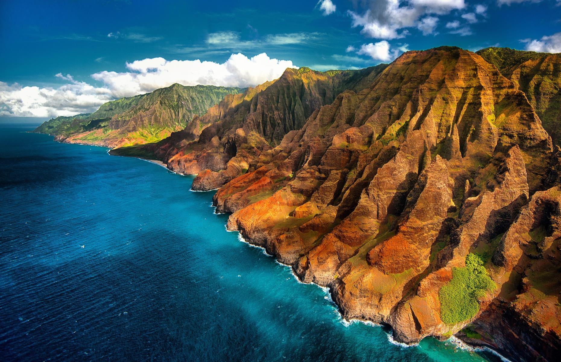 Slide 34 of 41: The grooves, peaks and bright colors of Nā Pali make it one of the most jaw-dropping stretches of Hawaii's coastline (no small achievement given the sheer beauty of the state's shores). Nā Pali ripples out for around 17 miles (27km), beaten by the North Pacific, whose waters attract humpback whales. The challenging Kalalau Trail wriggles through the landscape too. Take a look at more otherworldly spots in the USA.