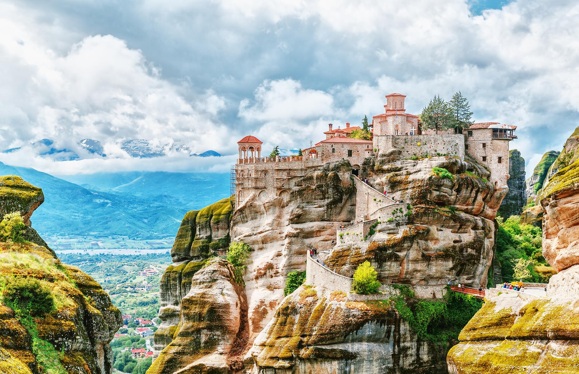 Slide 7 of 31: As clifftop monuments go, the Meteora Monasteries in Greece's Thessaly region are about as famous as they get. And it's not hard to see why. Perched upon 60 million-year old sandstone megaliths which rise an average of 1,000 feet (305m) into the air, these Byzantine monasteries are the rocks' crowning glory. Built between the 14th and 17th centuries, today the area is one of the most visited in Greece, although visitors must climb 200 dizzying steps to reach Roussanou, the most famous of the monasteries.