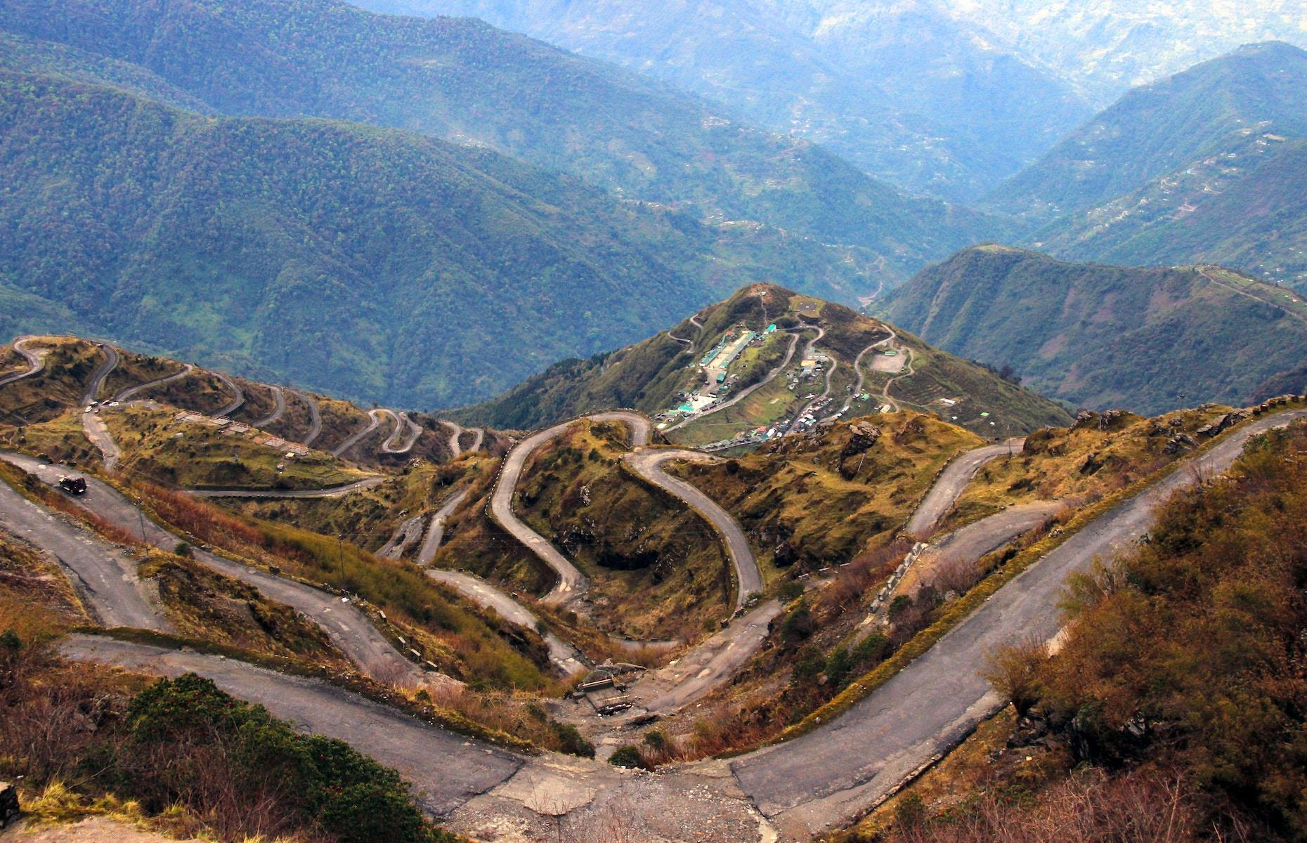 Slide 20 of 31: Draped in elegant spirals which traverse the rugged lower Himalayas, the Three Level Zigzag Road is as dizzying as it is breathtakingly beautiful. The treacherous trail starts at the village of Dzuluk and climbs up the mountain to Thambi View Point at 11,200 feet (3,400m) above sea level, complete with a stomach-churning 100 serpentine bends over the course of just 19 miles (30km).
