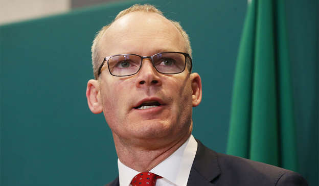 Simon Coveney wearing glasses and smiling at the camera: Speaking at the Oireachtas Committee on European Union Affairs, Mr Coveney said that there are many other negotiations that were required for a palatable Brexit. Pic: Sam Boal/RollingNews.ie
