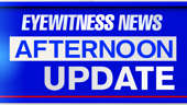 a blue sign sitting on the side: Eyewitness News Afternoon Update