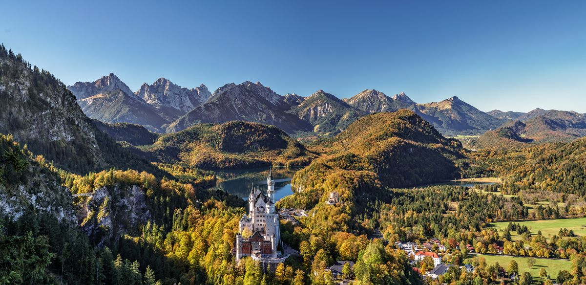 Slide 4 of 33: The changing leaves in the mountains of Bavaria give way to stunning views of Neuschwanstein Castle (and Oktoberfest!)