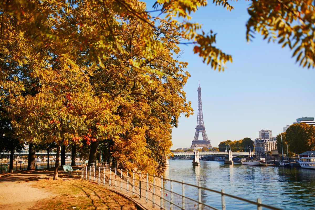 Slide 2 of 33: The iconic Eiffel Tower past the Seine river in Paris, France.