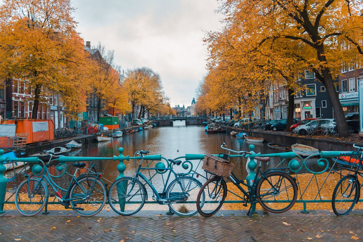 Slide 22 of 33: Bikes on a bridge over The Amstel river in Amsterdam, home to narrow, intricate houses and an impressive canal system.