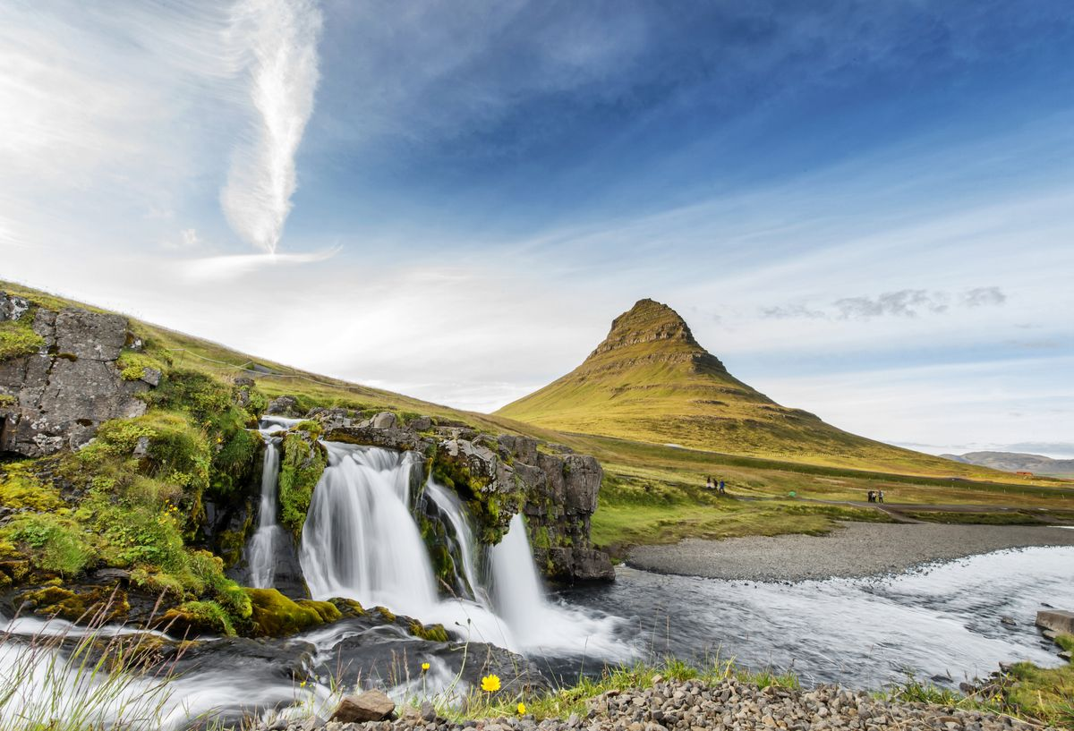 Slide 29 of 33: The majestic Kirkjufell mountain and waterfall in the town of Grundarfjörður on Iceland's north coast.