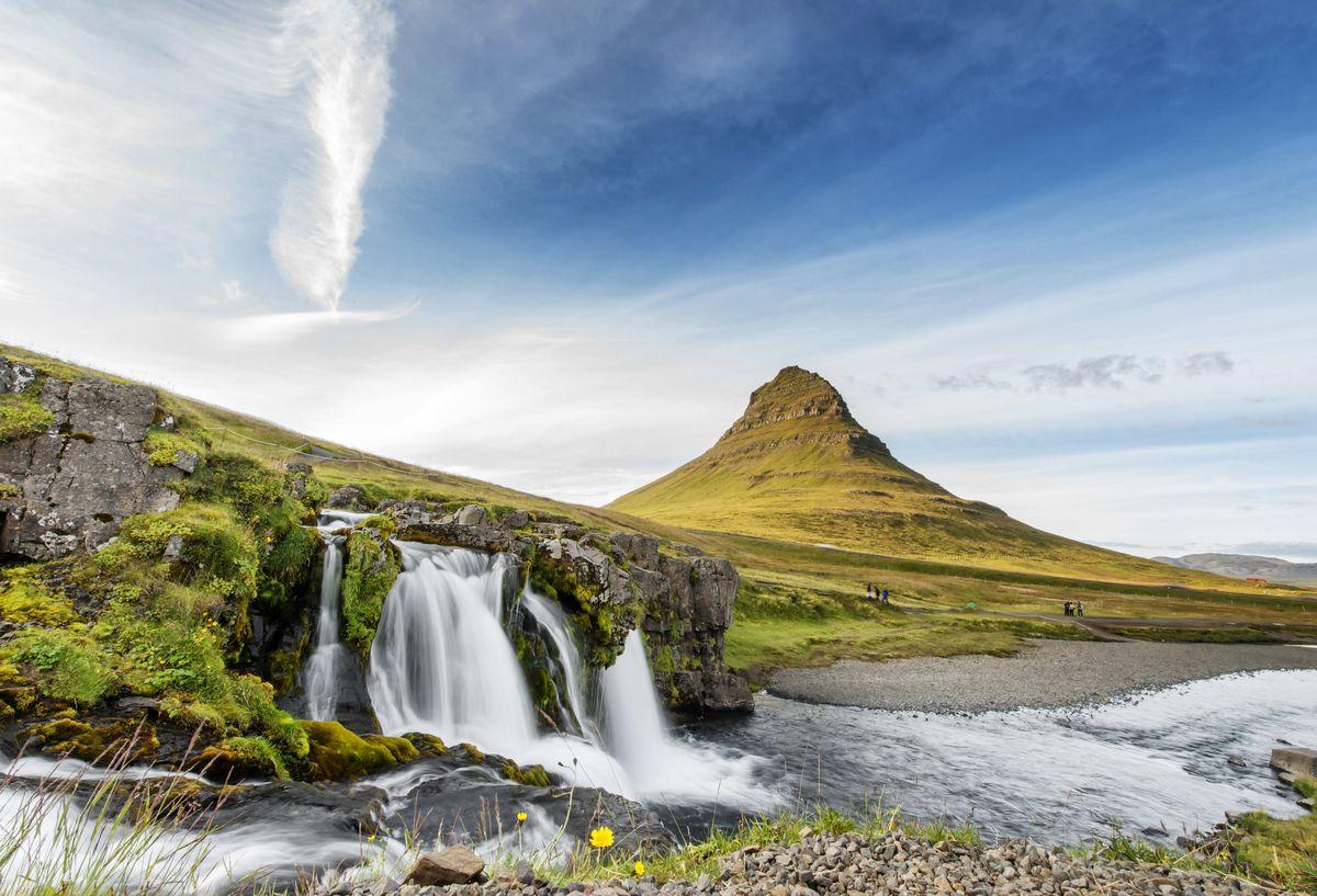 Slide 29 of 33: The majestic Kirkjufell mountain and waterfall in the town of Grundarfjörður on Iceland's north coast.