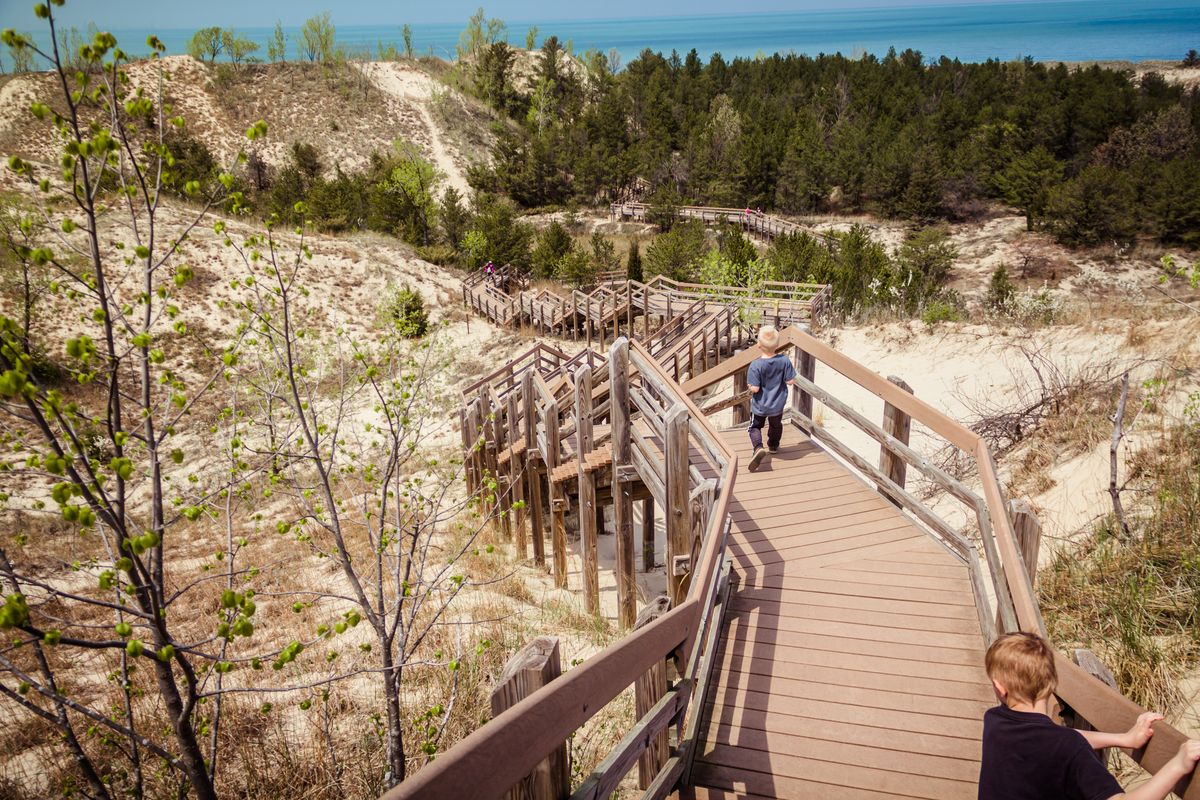 Slide 15 of 51: Indiana Dunes National ParkFormerly a National Lakeshore, this 15 mile stretch along Lake Michigan got an upgrade in 2019 to National Park. There are many ways to get to the lake, but the wooden staircases that safely traverse the dunes are the most fun (and exhausting).