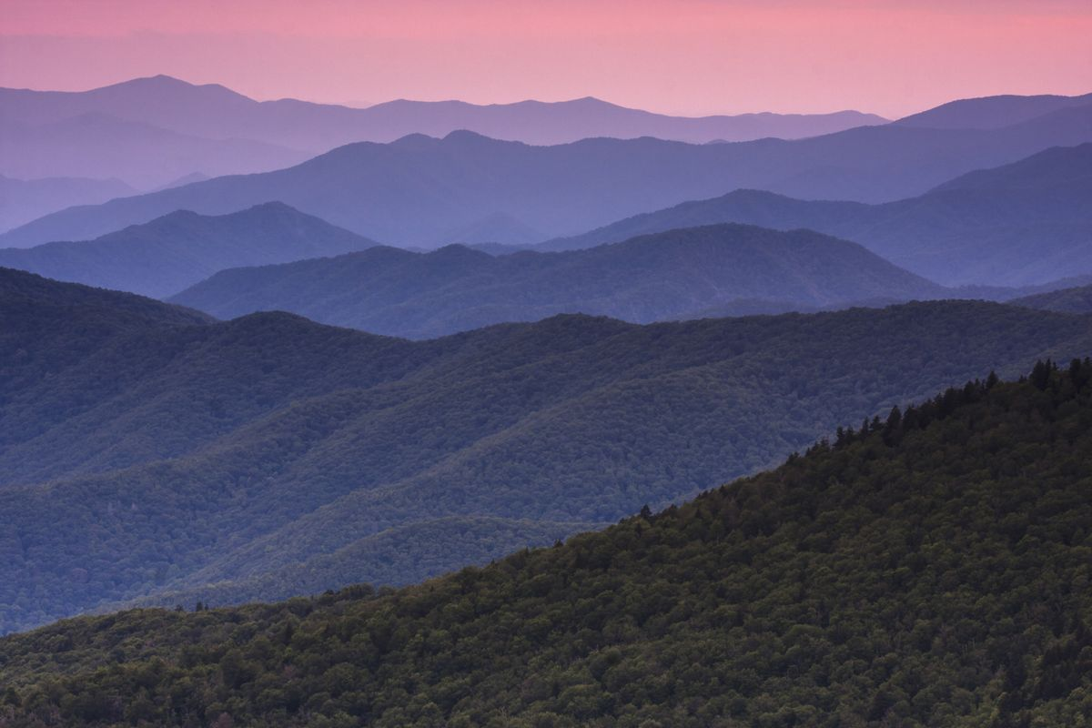 Slide 43 of 51: Great Smoky Mountains National Park This mountain range spans the borders of Tennessee and North Carolina and is the most popular national park, meaning you can expect crowds. But you can also expect stunning views and these smoky sunsets!