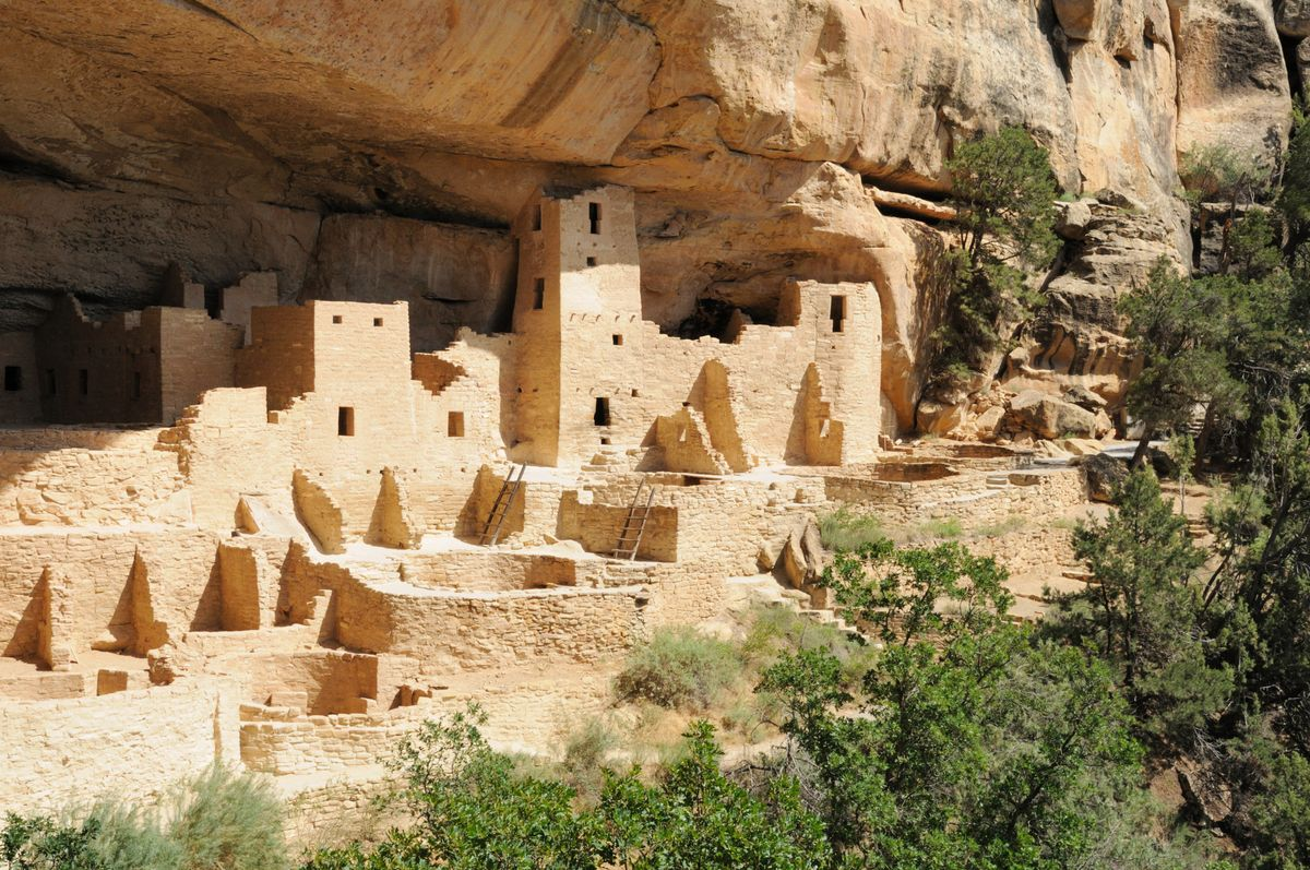 Slide 7 of 51: Mesa Verde National ParkThis park houses almost 5,000 archeological sites, including the famed cliff dwellings of the ancestral Pueblo people who lived here from 600 to 1300 CE.