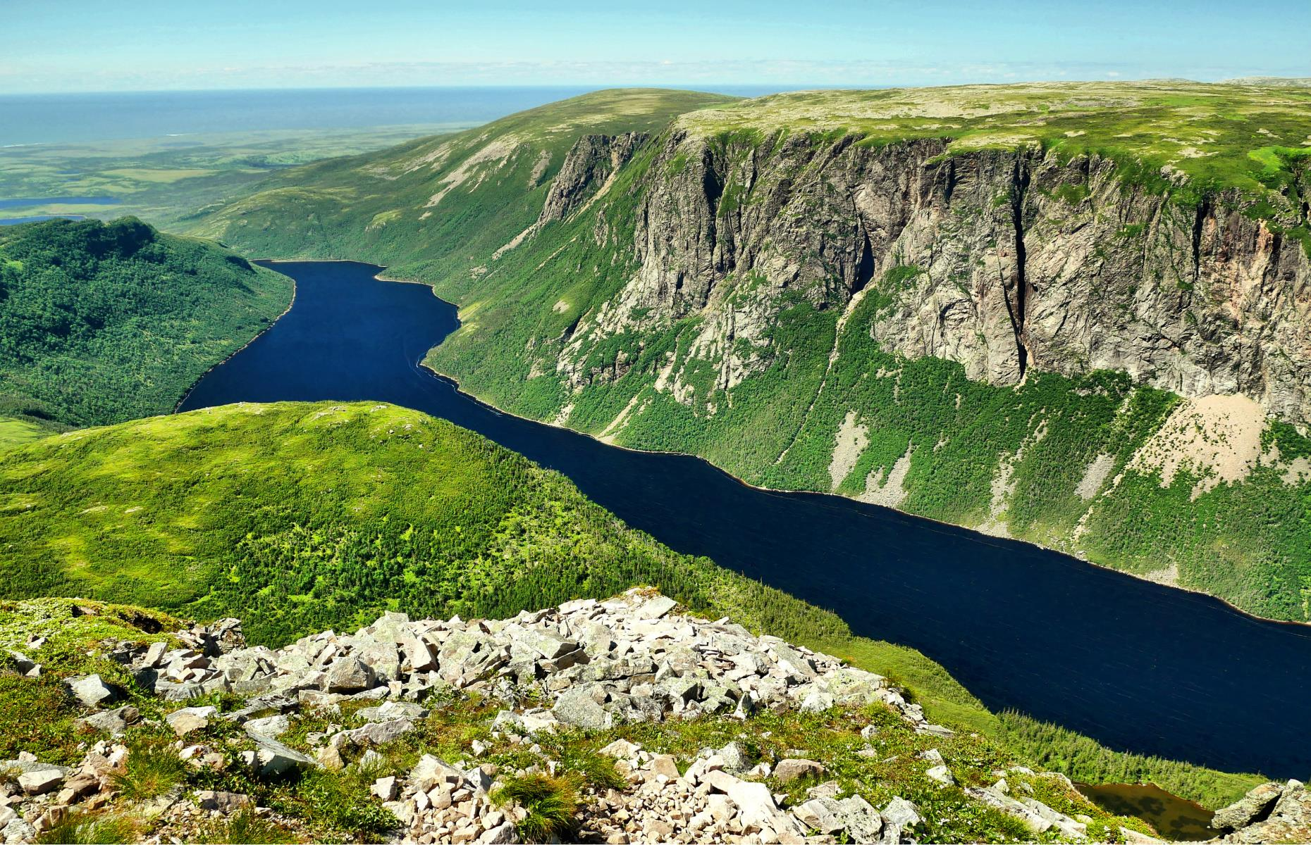 Slide 30 of 31: Situated on the west coast of Newfoundland, Gros Morne National Park is also a UNESCO World Heritage Site, recognized for its raw terrain and sheer variety of natural wonder. The glacier-formed landscape is favored by hikers, who walk in areas like the Tablelands, which were formed by plate tectonics millions of years ago. There are also mountains, beaches and sea stacks to be seen, with each natural feature telling a story about the formation of Earth. See more of the world's most beautiful natural wonders here.