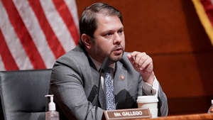 Ruben Gallego wearing a suit and tie sitting at a table: Democrats want Arizona to reject mapping firm's application to redraw districts