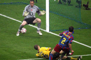 a group of men playing a game of football: Juliano Belletti's goal condemned Arsenal to defeat in the 2005/06 Champions League final
