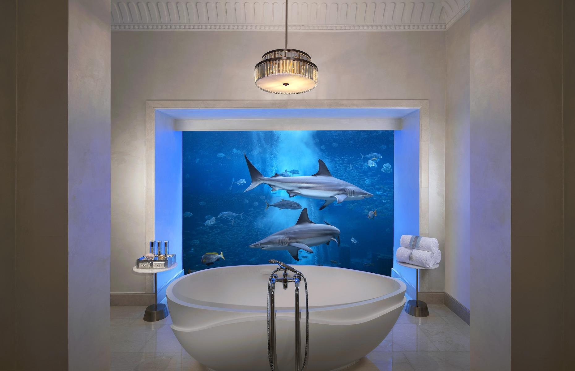 Slide 4 of 24: The twin underwater suites – which come with a private butler – have above-ground lounges where guests can gaze out at the lagoon's lapping water. Down below, the bedrooms and bathrooms have soaring floor-to-ceiling windows onto the private marine oasis, allowing guests to stare at the entrancing scene as they wallow in the bed or marble bath. For those wishing to get even closer to their colorful neighbors, the suite includes entry into the aquarium which can also arrange tank dives (although due to current COVID-19 restrictions, dives are not currently on offer).