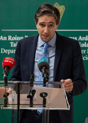 Simon Harris wearing a suit and tie: Pic: Julien Behal Photography