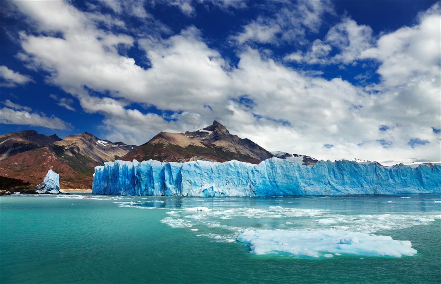 Slide 28 of 33: Located in Los Glaciares National Park, in the Santa Cruz province of Patagonia, Perito Moreno is a glacial giant measuring a staggering 18.6 miles (30km) in length. While many of the glaciers surrounding it are melting, Perito Moreno is actually growing.