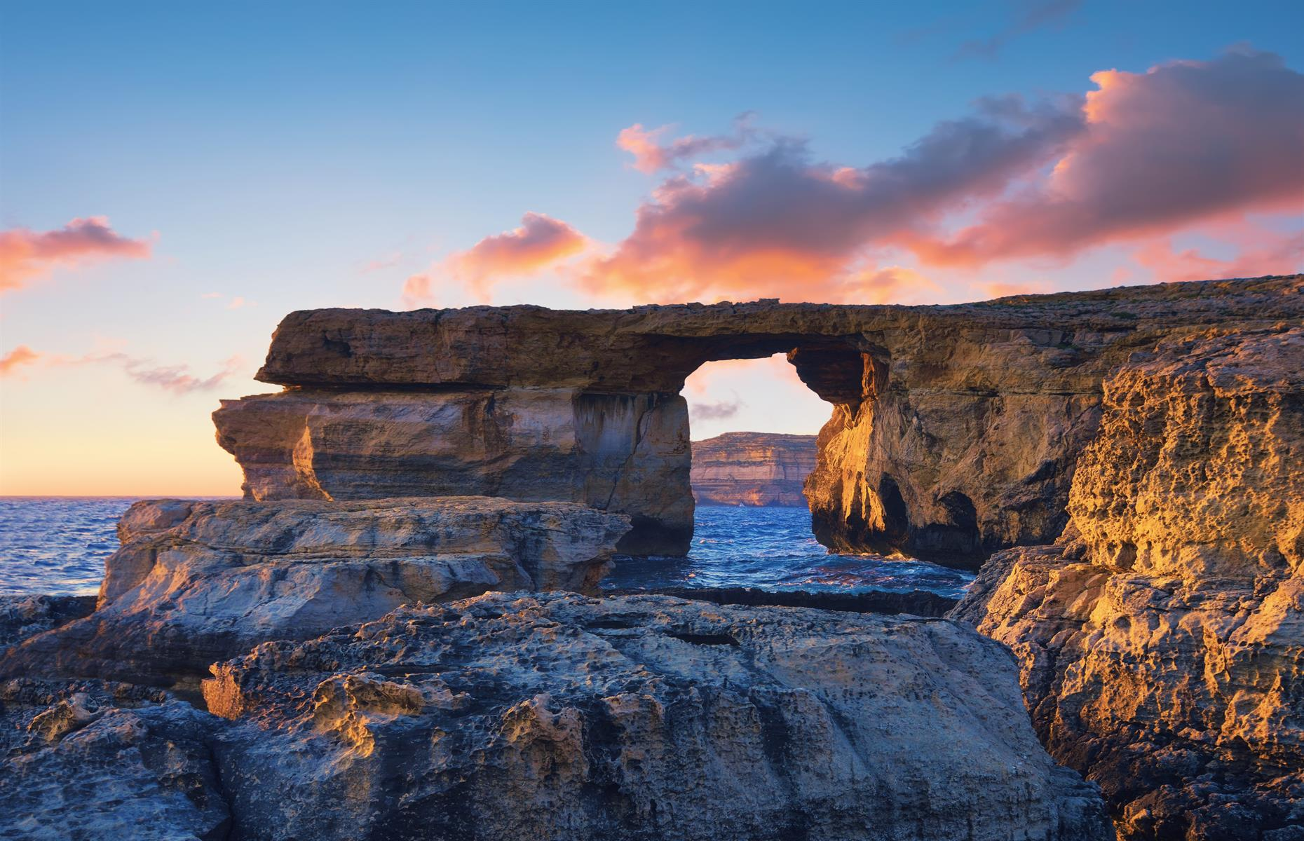 Slide 4 of 33: The Azure Window, a stunning limestone arch near Dwejra Bay on the island of Gozo, was shaped by years of natural coastal erosion. But Mother Nature was also its downfall – in 2017, the rock formation collapsed during a heavy storm. It was a huge draw for tourists visiting the island, especially at sunset.