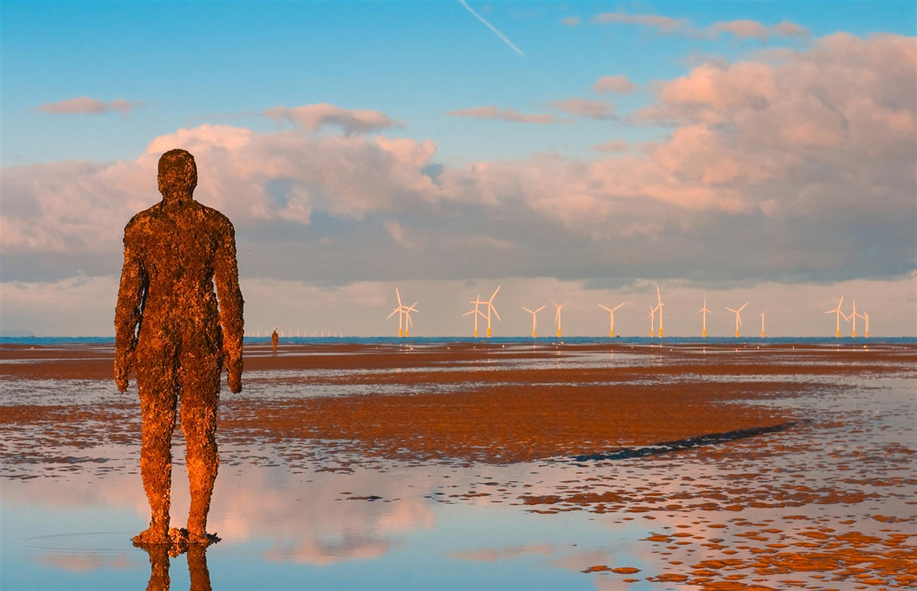 Slide 22 of 33: Antony Gormley's art installation called Another Place has been permanently installed at Crosby Beach, near Liverpool in northern England, since 2007. It's comprised of 100 statues, all modeled on the artist's own body.